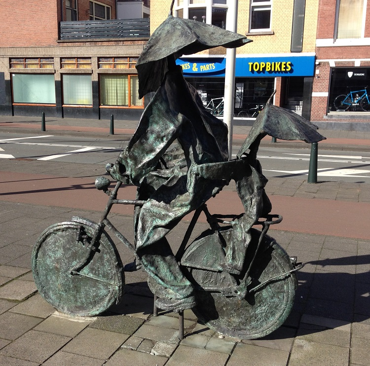 Dutch metal sculpture of bikers with umbrellas