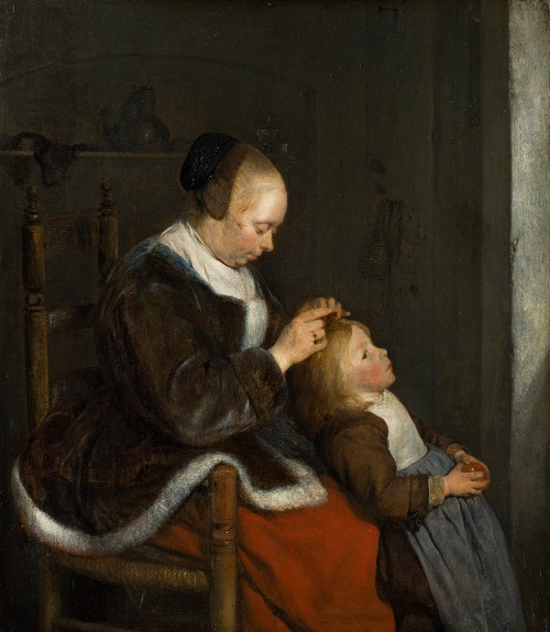 Mother combing her child's hair