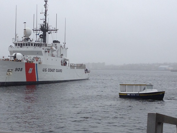 Boston water taxi and US Coast Guard boat