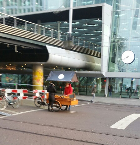 Selling oranges at The Hague's Centraal Station