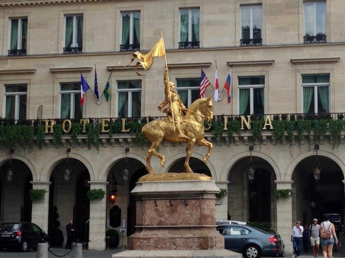 Joan of Arc statue in front of Hotel Regina in Paris