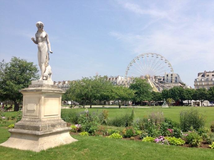 Statue in Tuileries garden, in Paris, with ferris wheel in background