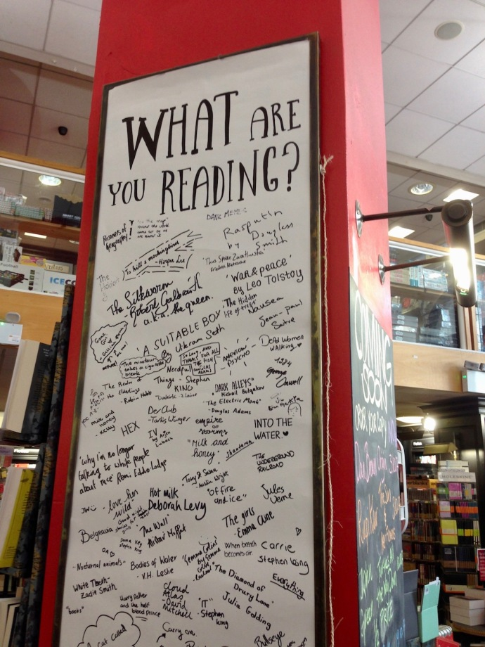 What are you reading board in American Book Center in Amsterdam, Sept 2017