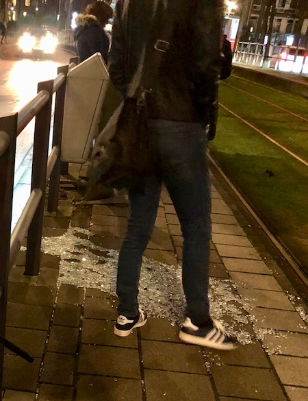 Broken glass at tram stop, The Hague