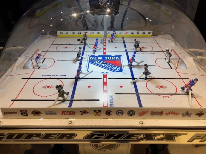 Foosball-esque table in NHL store in NYC