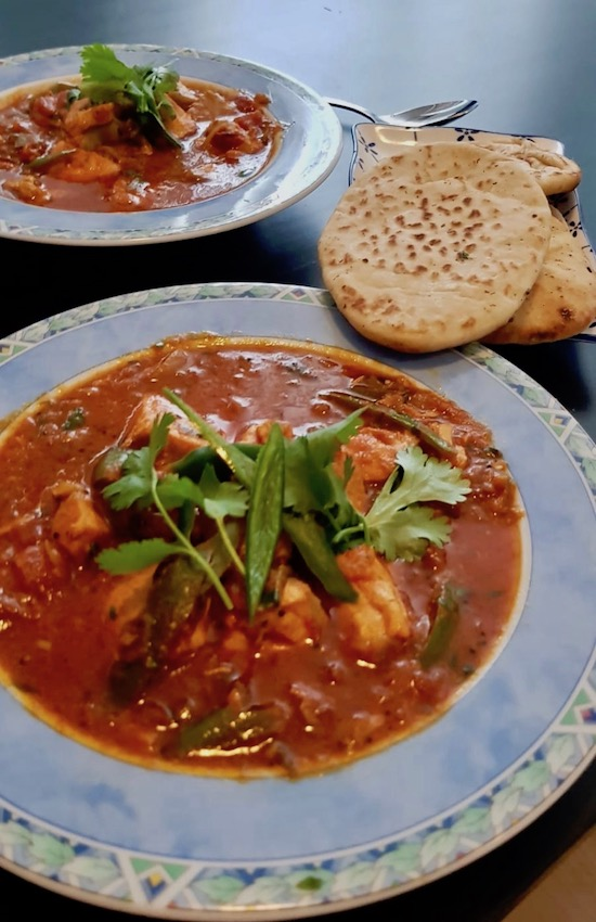 Salmon curry with naan bread